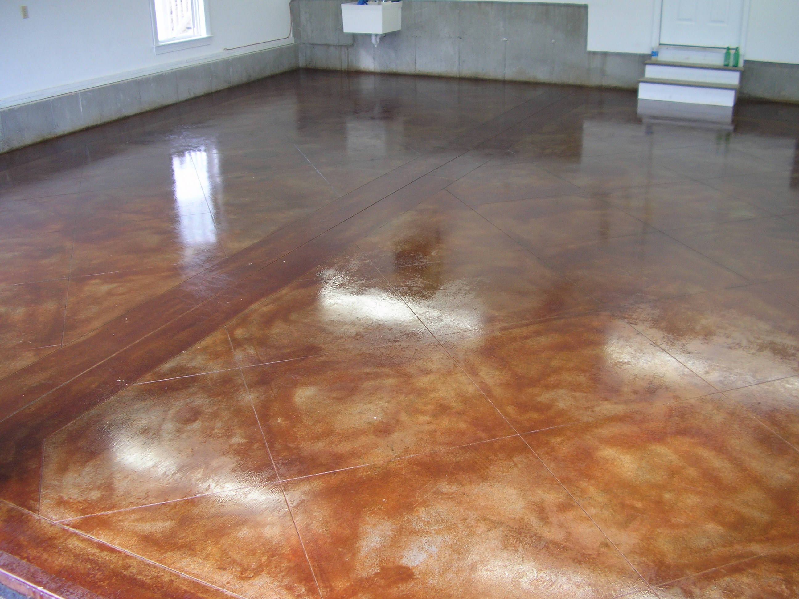 Acid stained concrete floors countertops lafountain garage for How to care for stained concrete floors