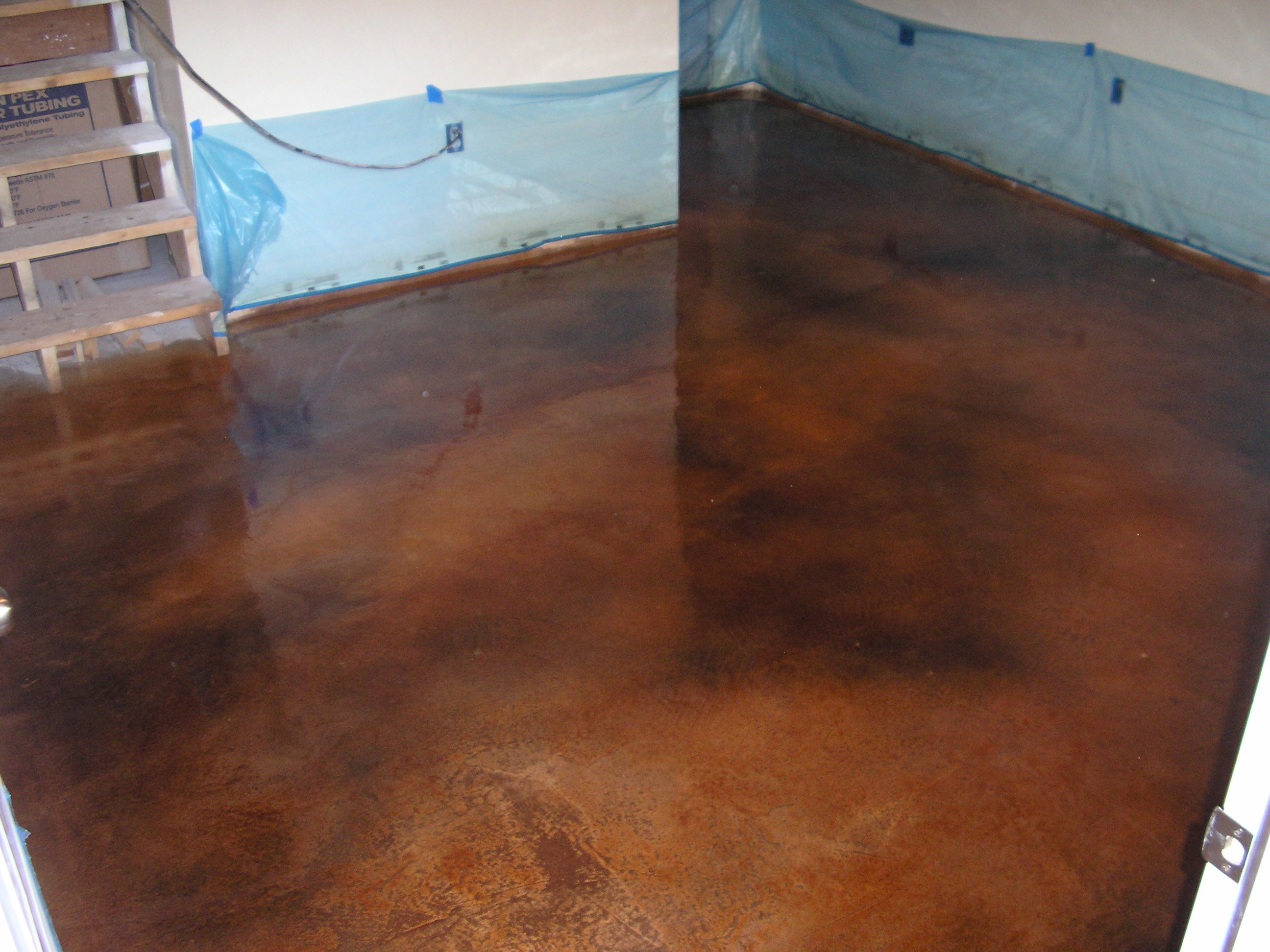 Acid stained concrete floors countertops lafrance basement for Black stains on concrete