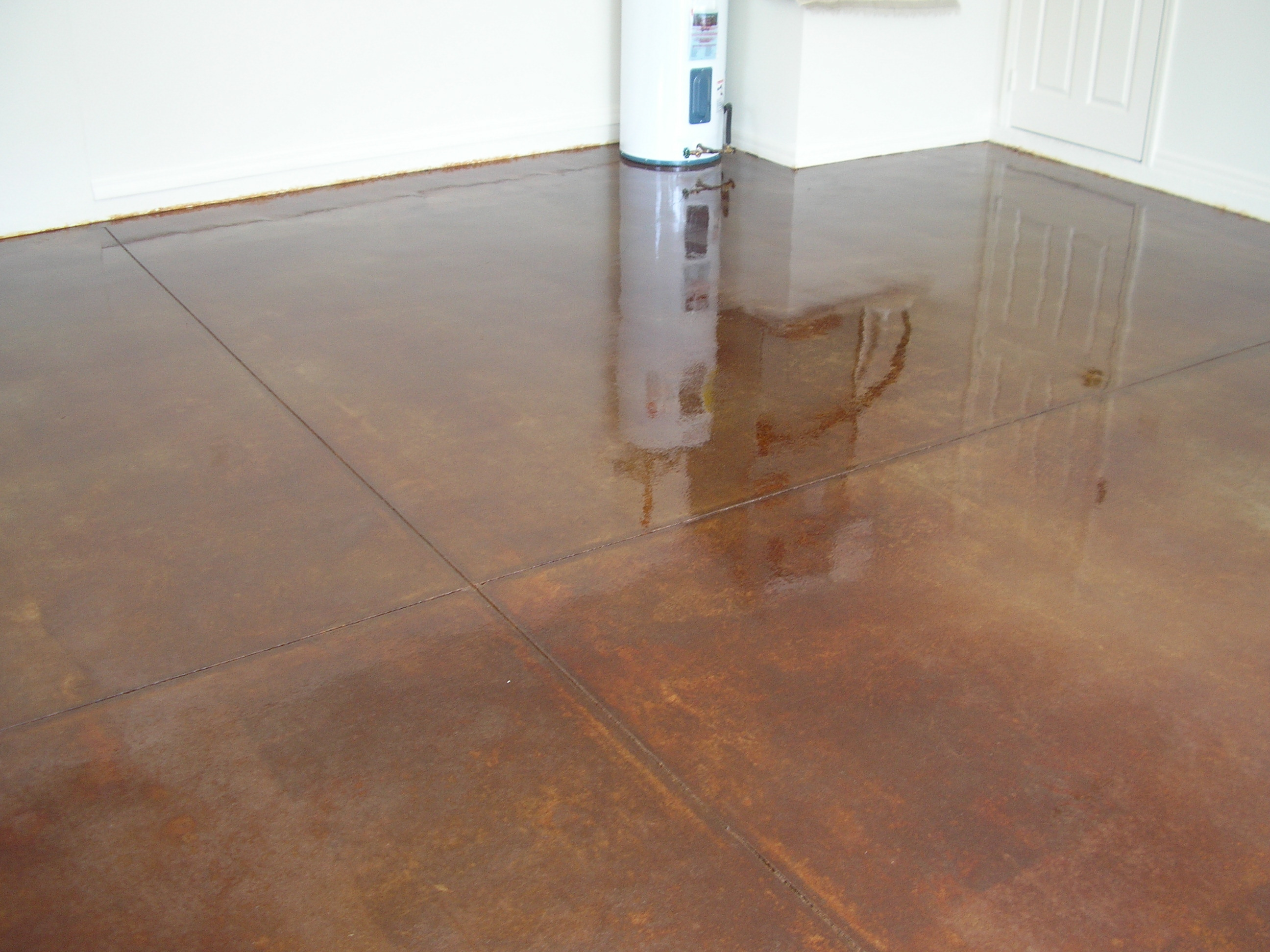 Acid stained concrete floors countertops montavlo garage for How to clean stained concrete garage floors